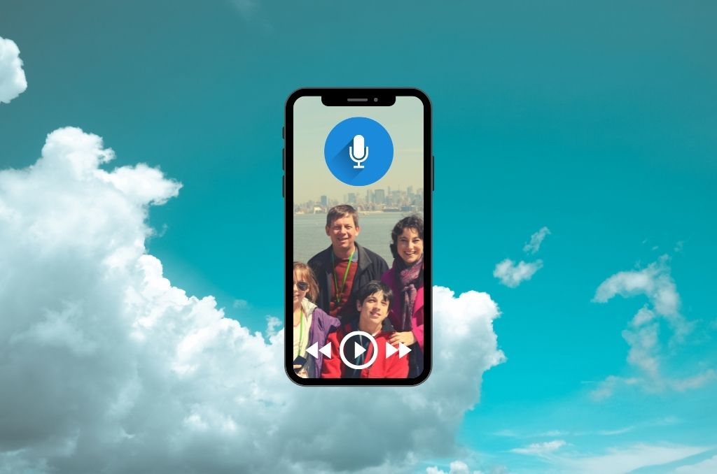 Background of blue sky with clouds, foreground of a phone with an image of a family of four on the screen, with a podcast logo at the top and play, backwards, and forwards icons at the bottom.