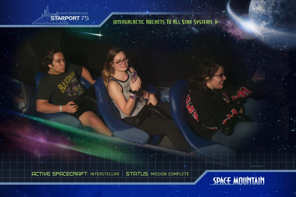 A Space Mountain memorial photograph, three people seated in a row on the ride.